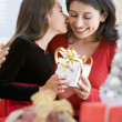 Girl Surprising Her Mother With Christmas Gift — Stok fotoğraf