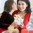 Girl Surprising Her Mother With Christmas Gift — Stock Photo #4778307