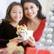 Girl Surprising Her Mother With Christmas Gift — Stock Photo