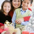 Mother With Her Daughter And Son Holding Christmas Gifts — Stockfoto