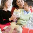Mother Sitting With Her Son And Daughter,Exchanging Christmas Gi — Foto de Stock