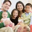 Family With New Born,Sitting On Sofa,Holding Christmas Gift - Stock Photo