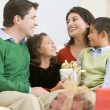Family Smiling At Each Other,Holding Christmas Gift — Stock Photo #4778316