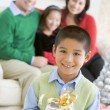 Young Boy Standing Holding Christmas Present,With His Parents An — Stock Photo