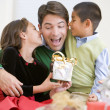 Father Being Given A Christmas Present By His Daughter And Son — Stock Photo #4778323