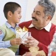 Boy Surprising Father With Christmas Present — Stock Photo #4778332