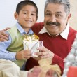 Boy Surprising Father With Christmas Present — Stock Photo #4778333