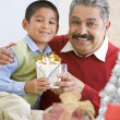 Boy Surprising Father With Christmas Present — Stockfoto #4778333
