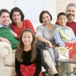 Family Sitting Around A Coffee Table And Christmas Gifts — Stock Photo