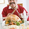 Stock Photo: Senior MExcitedly Getting Ready To Carve Turkey