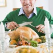 Man Excitedly Carving A Turkey — Stock Photo