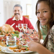 Grandfather And Granddaughter Sitting Down For Christmas Dinner — Stock Photo #4778363