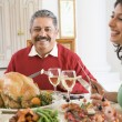 Father And His Adult Daughter Sitting Down For Christmas Dinner — Foto Stock #4778365