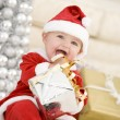 Baby In Santa Costume At Christmas — Stock Photo #4778366
