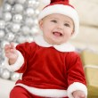 图库照片: Baby In Santa Costume At Christmas