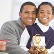 Father And Son Hugging,Holding Christmas Gift — Stockfoto #4778371