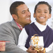Father And Son Hugging,Holding Christmas Gift — Stockfoto #4778373