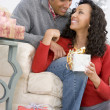 Husband And Wife Affectionately Exchanging Christmas Gifts — Stockfoto