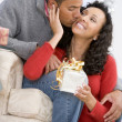 Stock Photo: Husband And Wife Affectionately Exchanging Christmas Gifts