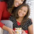 Mother Giving Daughter Her Christmas Present — Stockfoto
