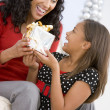 Mother Giving Daughter Her Christmas Present — Foto de Stock