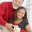 Grandfather Giving His Granddaughter A Christmas Present — Stock Photo #4778381
