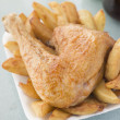 Stock Photo: Portion Of Chicken And Chips On Polystyrene Tray