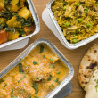 Selection Indian Take Away Dishes In Foil Containers — Stock Photo #4778560