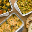 Selection Indian Take Away Dishes In Foil Containers - Lizenzfreies Foto