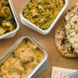 Chicken Korma, Sag Aloo, Mushroom Pilau And Naan Bread - Stock Photo