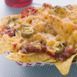 Portion Of Cheese And Chilli Nachoes - Stock Photo