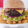 Stock Photo: Cheese Burger In Sesame Seed Bun With Fries