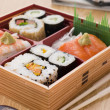 sushi and sashimi in a take away bento box — Stock Photo