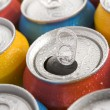 Close Up Of Multi Colored Soda Cans With One Open - Foto Stock