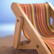 Miniature Deck Chair On Sand — Stock Photo