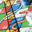 Close -Up Of Snakes And Ladders Board — Stock Photo #4778931