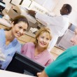 Nurses Talking At The Reception Area In A Hospital — Stock Photo #4779169