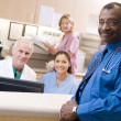 Doctors And Nurses At The Reception Area Of A Hospital — Stock Photo