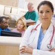 Stock Photo: Doctors And Nurses At Reception AreOf Hospital