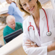 A Doctor And Nurses In The Reception Area Of A Hospital — Stock Photo #4779218