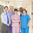 Hospital Team Standing In A Corridor - Stock Photo