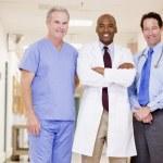 Doctors Standing In A Hospital Corridor — Stock Photo