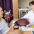 Nurse Serving A Patient A Meal In His Bed - Stock Photo
