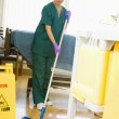 An Orderly Mopping The Floor In A Hospital Ward — Stock Photo