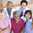 High Angle View Of Hospital Staff Standing Outside A Hospital - Foto Stock