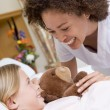 Stock Photo: Nurse Laughing With Her Young Patient