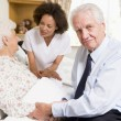 Stock Photo: Nurse Talking To Senior Couple