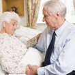 Stock Photo: Senior MVisiting His Wife In Hospital