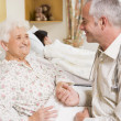 Stock Photo: Doctor Sitting With Senior WomIn Hospital