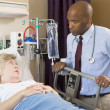 Doctor Checking Up On Patient In Hospital — Stock Photo